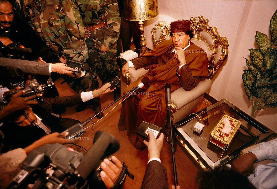 CHAD, N'DJAMENA AIRPORT-3/02/2000: The Libyan leader Muammar Abu Minyar al-Gaddafi during a press conference before the World Islamic Conference.<br /> <br /> TCHAD, N'DJAMENA-3/02/2000: Portrait du leader Libyen Mouammar Abu Minyar Kadhafi en conference de presse avant la Conference Islamique Mondiale.
