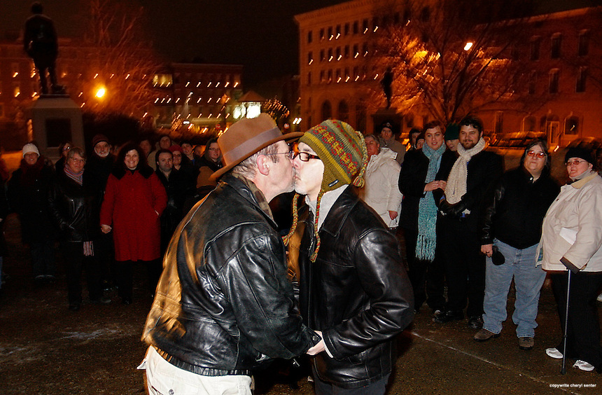 Olin Burkhart, center left, and Carl Burkhart, center right, both of Salem, N.H., wed on steps of New Hampshire's State Capitol New Year's Eve as the historic Marriage Equality law takes effect at midnight in Concord, N.H., January 1, 2010.   New Hampshire same sex couples can now officially marry or convert their vows from a civil union to a state-recognized marriage.  New Hampshire joins Massachusetts, Vermont, Connecticut and Iowa in allowing gay marriage in a move that reflects the state's changing demographics from reliably Republican and conservative to younger and more liberal.  .