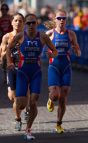 24 AUG 2013 - STOCKHOLM, SWE - Non Stanford (GBR) (right) of Great Britain keeps on the shoulder of team mate Jodie Stimpson (GBR) (centre) also of Great Britain during the run at the elite women's ITU 2013 World Triathlon Series round in Gamla Stan in Stockholm, Sweden (PHOTO COPYRIGHT © 2013 NIGEL FARROW, ALL RIGHTS RESERVED)