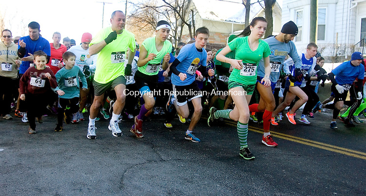NAUGATUCK, CT. 09 March 2013-030913SV04-Runners take off at the start of the Saint Patrick's Day 5K in the Union City section of Naugatuck Saturday. The event raises money for the Naugatuck Education Foundation..Steven Valenti Republican-American