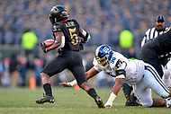 PHILADELPHIA, PA - DEC 8, 2018: Navy Midshipmen defensive end Jarvis Polu (90) atempts to tackle Army Black Knights running back Kell Walker (5) during game between Army and Navy at Lincoln Financial Field in Philadelphia, PA.Army defeated Navy 17-10 to win the Commander in Chief Cup. (Photo by Phil Peters/Media Images International)