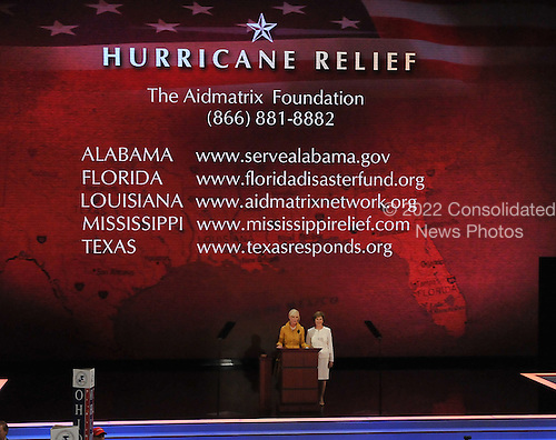St. Paul, MN - September 1, 2008 -- Mrs. Cindy McCain, wife of United States Senator John McCain, left, and first lady Laura Bush, right appeal for help to aid affected parts of the Gulf Coast in the aftermath of Hurricane Gustav on day 1 of the 2008 Republican National Convention in Saint Paul, Minnesota on Monday, September 1, 2008..Ron Sachs / CNP.(RESTRICTION: NO New York or New Jersey Newspapers or newspapers within a 75 mile radius of New York City)