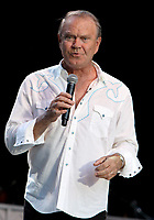 Glen Campbell <br /> made a stop along with Kenny Rogers at the Chastain Park Amphitheater in Atlanta, GA., as part of his &quot;Goodbye Tour.&quot; Campbell performed all his hits as well as some of his favorite cover songs for enthusiastic fans. Atlanta, GA, ISA, July 14th, 2012.<br /> half length white shirt microphone country music live on stage concert gig <br /> CAP/ADM/DH<br /> &copy;Dan Harr/AdMedia/Capital Pictures