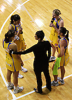Pulse coach Yvette McCausland-Durie consoles Jamilah Gupwell (bottom left) after the one-point extra-time loss, along with (from left) Paula Griffin, Camilla Lees and Ngarama Milner-Olsen during the ANZ Netball Championship match between the Central Pulse and Northern Mystics, TSB Bank Arena, Wellington, New Zealand on Monday, 4 May 2009. Photo: Dave Lintott / lintottphoto.co.nz