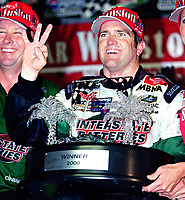 NASCAR driver Bobby Labonte celebrates his third win of the season after the rain-shortened Pepsi Southern 500 in Darlington, SC on Sunday, 9/3/00.(Photo by Brian Cleary)