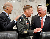 Washington, D.C. - September 10, 2007 -- United States Senators Joseph Biden (Democrat of Delaware), left, and Christopher Dodd (Democrat of Connecticut), right, and United States Army General David H. Petraeus, Commander of the Multi-National Force - Iraq (MNF-I), center, share smiles prior to the General's testimony on the future course of the war in Iraq while appearing before a hearing of the United States Senate Foreign Relations Committee, on Capitol Hill in Washington, D.C. on Tuesday, September 11, 2007..Credit: Ron Sachs / CNP.(RESTRICTION: No New York Metro or other Newspapers within a 75 mile radius of New York City)