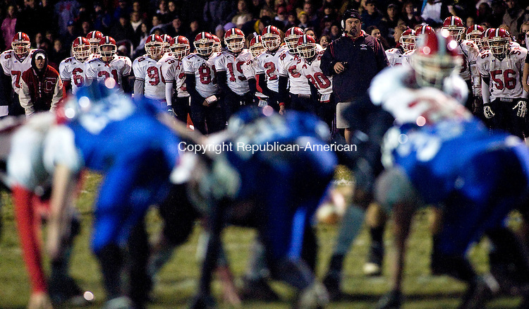 SOUTHINGTON, CT - 26 NOVEMBER 2008 -112608JT03-<br /> Cheshire players watch as their team scores a field goal during Wednesday's Cheshire-Southington Thanksgiving Day Apple Classic at Southington. Cheshire won, 9-7.<br /> Josalee Thrift / Republican-American