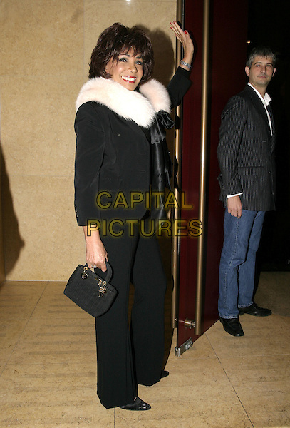 "SHIRLEY BASSY.Launch party for Joan Collins' new book, ""Misfortune's Daughters"", Frankies, Yeoman's Row, London, .October 19th 2004..full length white fue stole cape wrap black ribbon bow.Ref: AH.www.capitalpictures.com.sales@capitalpictures.com.©Capital Pictures."