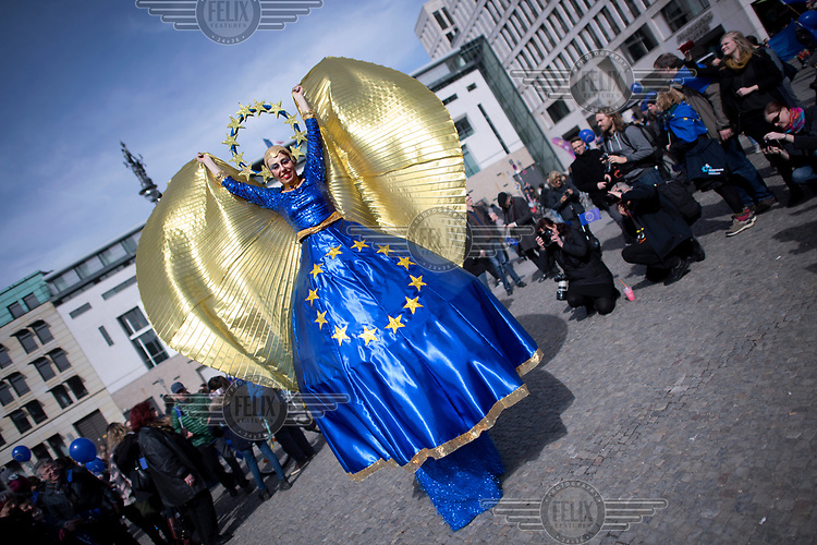 A woamn dressed as Europa at a pro-EU rally, the 'March for Europe', organised by the European Movement to celebrate the 60th anniversary of the Treaty of Rome.