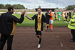 Home team player Darren Lavery is congratulated by a coach at Shielfield Park, at the conclusion of the Scottish League Two fixture between Berwick Rangers and East Stirlingshire (orange shirts). The home club occupied a unique position in Scottish football as they are based in Berwick-upon-Tweed, which lies a few miles inside England. Berwick won the match by 5-0, watched by a crowd of 509.