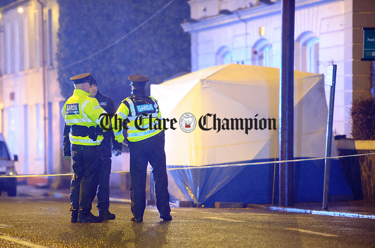 Gardai at the scene in Kildysart where they are investigating the circumstances surrounding the deaths of a married couple. Photograph by John Kelly.