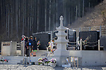 Children visit a shrine next to the ruins of Okawa Elementary School on March 11, 2016 in Ishinomaki, Miyagi Prefecture, Japan. Exactly 5 years earlier 74 out of the school's 108 students lost their lives as a result of the tsunami on March 11th, 2011. There are plans to rebuild the school but as yet this has not been fixed. The fate of the destroyed buildings is also expected to be decided soon with residents of the town divided as to whether they should be preserved as a memorial or removed. (Photo by Yusuke Nakanishi/AFLO)