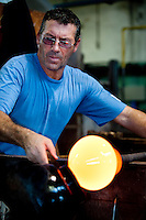 Stefano Vedova, the 'Maestro' or master of his glass blowing team, with his 'serventi' or crew at the Nasonmoretti furnace on Murano, Venice, Italy