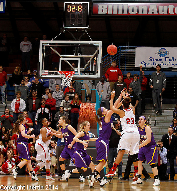 SIOUX FALLS, SD - MARCH 9:  xxxxxxxx #23 from the University of South Dakota knocks down a three pointer to take the lead over Tori Niemann #21 from Western Illinois in the second half of their semifinal game at the 2014 Summit League Tournament in Sioux Falls, SD.  (Photo by Dave Eggen/Inertia)