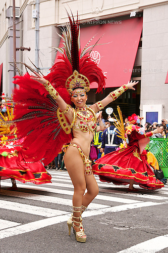A dancer poses for the camera during the 33rd Samba Carnival on August 23, 2014 at Asakusa district in Tokyo, Japan. About 495,000 people came out to see 16 groups with 4700 contestants celebrating the 33rd Samba Carnival in Asakusa. This is one of the biggest Samba Event outside of Brazil. (Photo by Rodrigo Reyes Marin/AFLO)