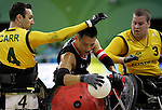 Ian Chan (centre) of Surrey, B.C. is defended by Ryley Batt (3) and Cameron Carr of Australia in Canada's 41 - 40 loss to Australia in wheelchair rugby semi-final action in Beijing during the Paralympic Games, Monday, Sept., 15, 2008.   Photo by Mike Ridewood/CPC