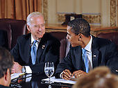 Chicago, IL - November 7, 2008 -- United States President elect Barack Obama (R) and Vice president elect Joseph Biden (L) meet with members of the Transition Economic Advisory Board at the Hilton Hotel in downtown Chicago, Illinois, USA 07 November 2008. Obama later held his first news conference since winning the election..Credit: Tannen Maury - Pool via CNP