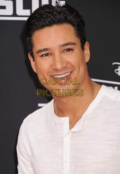 HOLLYWOOD, CA- JULY 15: TV personality Mario Lopez arrives at the Los Angeles premiere of Disney's 'Planes: Fire &amp; Rescue' at the El Capitan Theatre on July 15, 2014 in Hollywood, California.<br /> CAP/ROT/TM<br /> &copy;Tony Michaels/Roth Stock/Capital Pictures