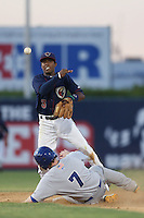 Tony Kemp #3 of the Lancaster JetHawks throws to first base after forcing out Billy McKinney of the Stockton Ports #7 at second base during a game at The Hanger on June 24, 2014 in Lancaster, California. Stockton defeated Lancaster, 6-4. (Larry Goren/Four Seam Images)
