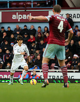 Sunday 07 December 2014<br /> Pictured L-R: Ki Sung Yueng of Swansea and Kevin Nolan of West Ham<br /> Re: Premier League West Ham United v Swansea City FC at Boleyn Ground, London, UK.