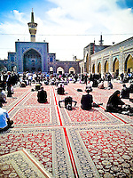 Pilgrims praying in one of the courtyards of the sanctuary of Imam Reza, 8th Imam of Shia muslims.