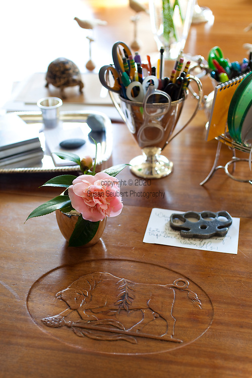 The Portland, Oregon home of Wendy Burden, author of  the memoir, Dead End Gene Pool.  The dining room table was a gift to Ms. Burden's great-grandfather (on her father's side) by his Harvard AD Club Members as a wedding gift.  Ms. Burden's father's brass knuckles along with other memorabilia on the table.