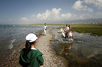 Tourists visiting Qinghai Lake. Qinghai Lake, China's largest inland body of water lies at over 3000m on the Qinghai-Tibetan Plateau. The lake has been shrinking in recent decades, as a result of increased water-usage for local agriculture. Qinghai Province. China. 2010