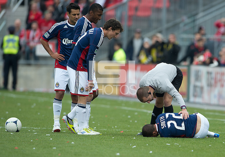 14 April 2012: Chivas USA midfielder Ryan Smith #22 hurt on the pitch as referee Mark Geiger assists during a game between Chivas USA and Toronto FC at BMO Field in Toronto..Chivas USA won 1-0.