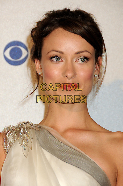 OLIVIA WILDE.Pressroom at the 36th Annual People's Choice Awards held at the Nokia Theatre LA Live, Los Angeles, California, USA..January 6th, 2009.press room headshot portrait white cream beige grey gray one shoulder pearls beads beaded pink lipstick hair up.CAP/ADM/BP.©Byron Purvis/AdMedia/Capital Pictures.