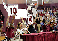 TALLAHASSEE, FLA. 10/15/10-FSUMBB 101510 CH-Judges score Florida State's Deividas Dulkys after he slam dunked a football during the dunk Friday at Tully Gym in Tallahassee. Dulkys won the contest...COLIN HACKLEY PHOTO