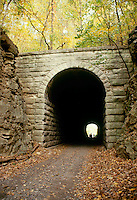 Tunnel through rock bridge on bike path