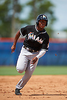 GCL Marlins pinch runner Terry Bennett (27) runs to third during the first game of a doubleheader against the GCL Mets on July 24, 2015 at the St. Lucie Sports Complex in St. Lucie, Florida.  GCL Marlins defeated the GCL Mets 5-4.  (Mike Janes/Four Seam Images)