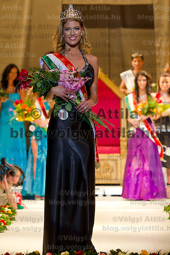 Dora Gregori (center) celebrates winning the Miss Hungary 2010 beauty contest held in Budapest, Hungary on November 29, 2010. ATTILA VOLGYI