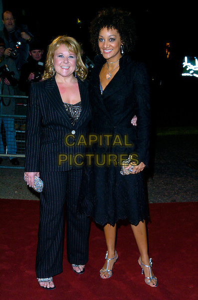 "WENDI PETERS & GUEST.Arrives at ""An Audience With Take That"".at The London Television Studios,.London, England, December 2nd 2006..full length.CAP/CAN.©Can Nguyen/Capital Pictures"