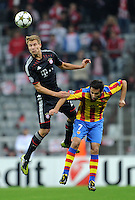 19.09.2012. Munich, Germany.  Munichs Holger Badstuber (L) and Jonas of Valencia challenge for the ball during the UEFA Champions League group F soccer match between Bayern Munich and Valencia CF at the football  Arena M in Munich, Germany, 19 September 2012.