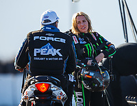 Jan. 31, 2018; Chandler, AZ, USA; NHRA top fuel driver Brittany Force (right) talks with father John Force during Nitro Spring Training pre season testing at Wild Horse Pass Motorsports Park. Mandatory Credit: Mark J. Rebilas-USA TODAY Sports
