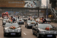 "Love in Modern China..This is a caravan to a mass wedding at the Rose Wedding Festival...Every time young Chinese are surveyed, they say that money is more important than love.  Money is the PRIMARY concentration of this new ""Little Capitalist"" class.  Money is happening so quickly around this group of 20 and 30 somethings that relationships take a back seat to getting ahead financially.  As they try so hard to match all the success around them they are also saying to themselves ""Hey... I need someone to love."""