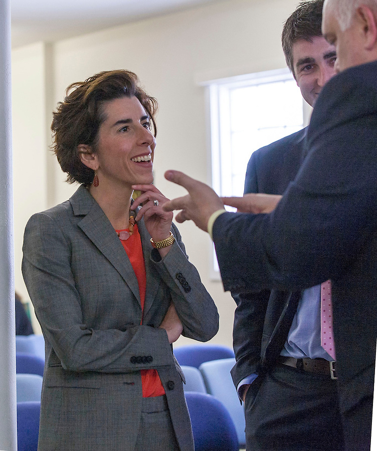 Rhode Island General Treasurer Gina Raimondo meets fellow panelists at the Center for Women and Enterprise in Providence, RI.