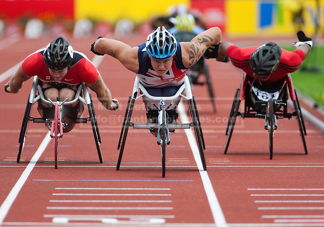 Athletes take part in a wheelchair sprint event at the 2010 London Disability Athletics Challenge at Crystal Palace. London, 2010.