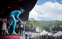 Fabio Aru (ITA/Astana) celebrating his stage victory with champaign<br /> <br /> Giro d'Italia 2015<br /> stage 19: Gravellona Toce - Cervinia (236km)