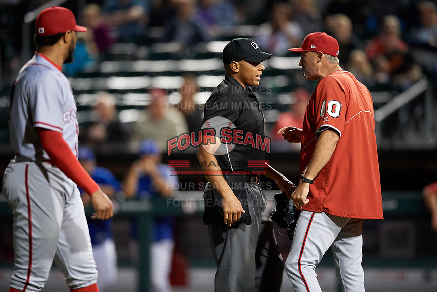 Syracuse Chiefs manager Randy Knorr (40) argues the ejection of relief pitcher Jimmy Cordero (left) with home plate umpire Jeremie Rehak during a game against the Buffalo Bisons on July 6, 2018 at Coca-Cola Field in Buffalo, New York.  Buffalo defeated Syracuse 6-4.  (Mike Janes/Four Seam Images)