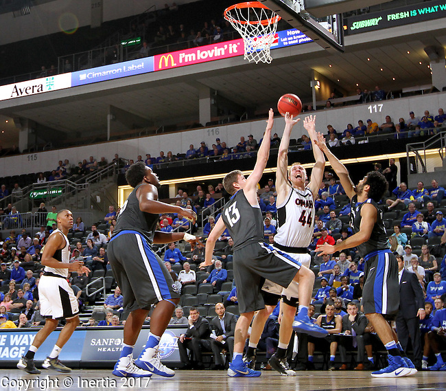 SIOUX FALLS, SD: MARCH 5: Mitch Hahn #44 from Omaha tries to get a shot off past Jax Levitch #13 from Fort Wayne during the Summit League Basketball Championship on March 5, 2017 at the Denny Sanford Premier Center in Sioux Falls, SD. (Photo by Dave Eggen/Inertia)