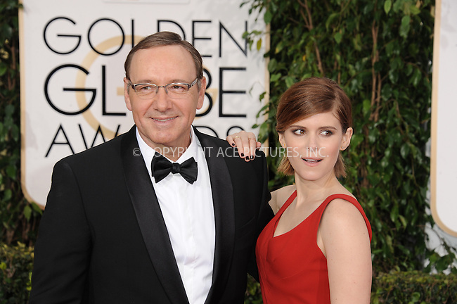 WWW.ACEPIXS.COM<br /> <br /> January 11 2015, LA<br /> <br />  Actor Kevin Spacey (L) and actress Kate Mara arriving at the 72nd Annual Golden Globe Awards at The Beverly Hilton Hotel on January 11, 2015 in Beverly Hills, California.<br /> <br /> <br /> By Line: Peter West/ACE Pictures<br /> <br /> <br /> ACE Pictures, Inc.<br /> tel: 646 769 0430<br /> Email: info@acepixs.com<br /> www.acepixs.com