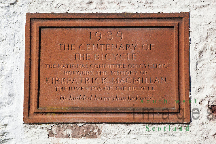 Plaque to the inventor of the bicycle Kirkpatrick Macmillan on side of Courthill Smithy near Keir Mill Scotland UK