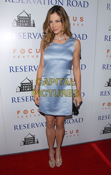 "MIRA SORVINO.The L.A. Premiere of ""Reservation Road"" held at The Academy of Motion Picture Arts & Sciences in Beverly Hills, California on .October 18th, 2007.full length blue satin silk dress silver shoes clutch purse bag .CAP/DVS.©Debbie VanStory/Capital Pictures"