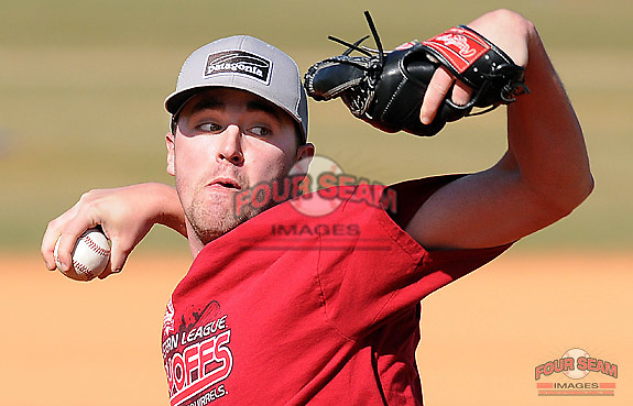 Former Spartanburg Methodist College pitcher Heath Hembree, now with the San Francisco Giants organization, works out with his former coaches for the SMC baseball team on Feb. 15, 2012 in Spartanburg, South Carolina. (Tom Priddy/Four Seam Images)