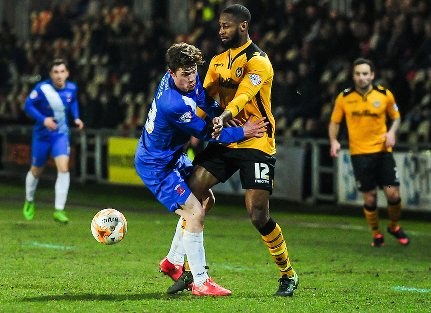 Hartlepool United's Luke James battles with  Newport County's Janoi Donacien <br /> <br /> Photographer Craig Thomas/CameraSport<br /> <br /> Football - The Football League Sky Bet League Two - Newport County v Hartlepool United - Tuesday 15th March 2016 - Rodney Parade - Newport<br /> <br /> &copy; CameraSport - 43 Linden Ave. Countesthorpe. Leicester. England. LE8 5PG - Tel: +44 (0) 116 277 4147 - admin@camerasport.com - www.camerasport.com