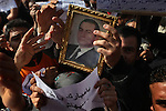 Pro-Mubarak demonstrators held up a portrait of Hosni Mubarak near Tahrir Square, Cairo, Egypt, Feb. 2, 2011. Protesters supporting Mubarak marched onto the square, the site where hundreds of thousands of demonstrators gathered yesterday to demand President Hosni Mubarak step down.