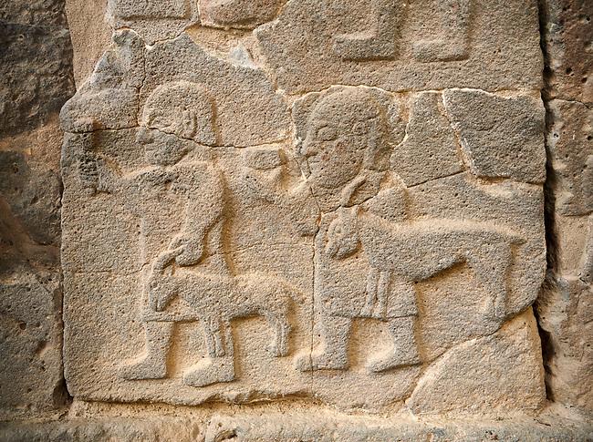 Pictures & images of the South Gate Hittite sculpture stele depicting figures leading goats to sacrifice. 8th century BC. Karatepe Aslantas Open-Air Museum (Karatepe-Aslantaş Açık Hava Müzesi), Osmaniye Province, Turkey.