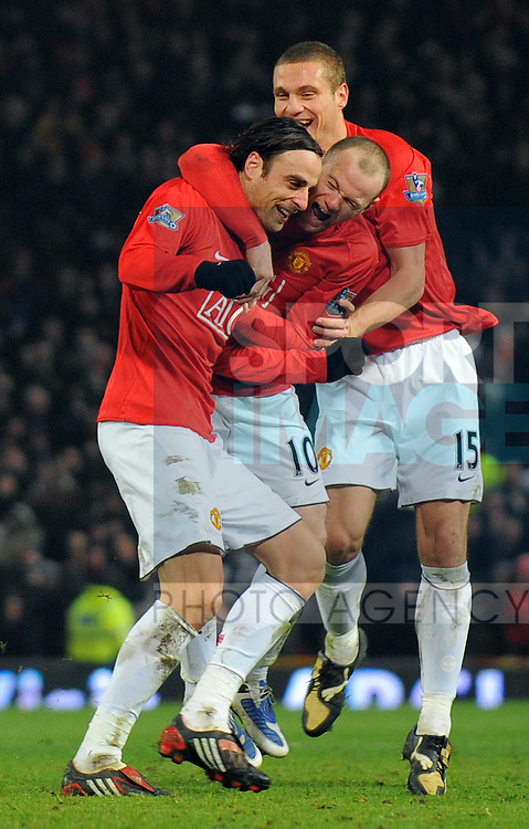 Dimitar Berbatov of Manchester United celebrates his goal with Wayne Rooney and Nemanja Vidic of Manchester United